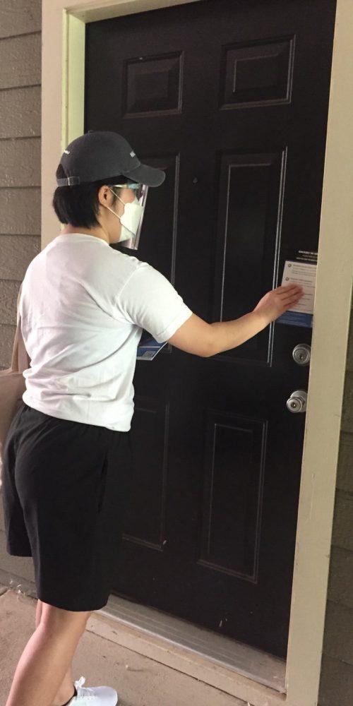 NAKASEC VA's Summer 2021 NLC intern Hana Cho leaving canvassing materials at a door